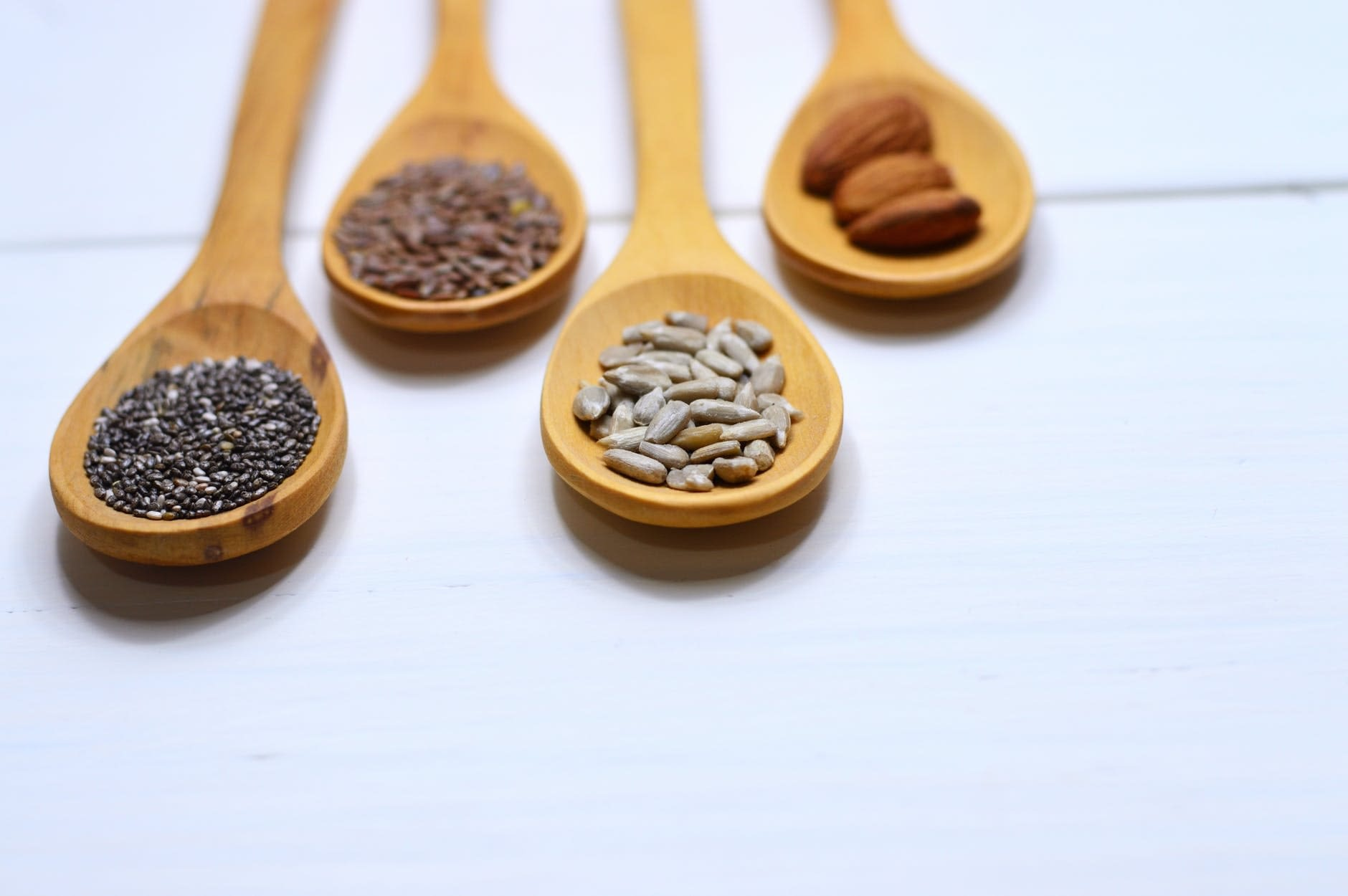 four brown wooden spoons screenshot